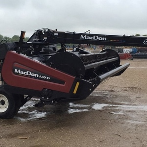 Medium macdon industries a 30d windrower 2