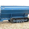 Thumb kinze grain cart