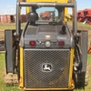 Thumb deere 323d skid steer loader 1