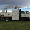 International 4900 service truck with knuckle boom